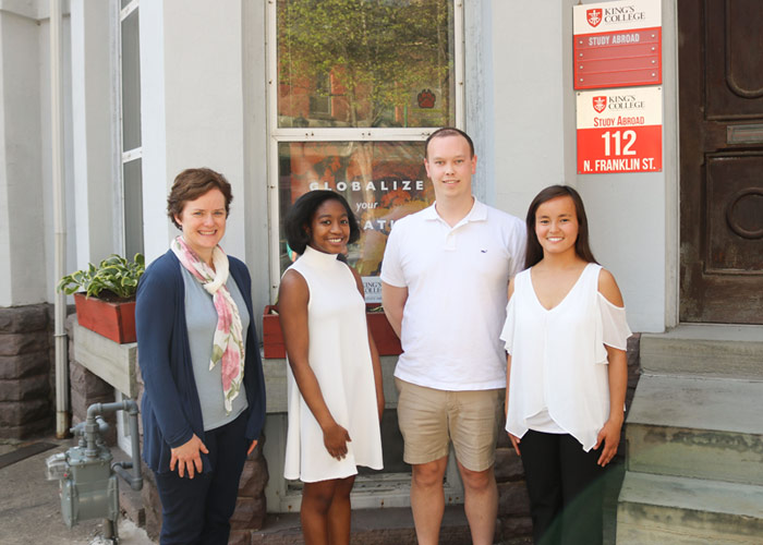 Pictured with Margaret Kowalsky, director of the Study Abroad Program, is, from left, Montgomery, Emmett, and Argiris.
